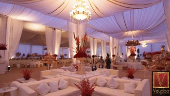 Photo of white and red theme wedding decor