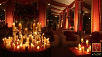 Photo of red and gold theme candle lit decor