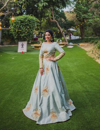 Ice blue and gold crop top lehenga