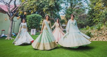 Twirling bride with bridesmaids in Pastel lehengas