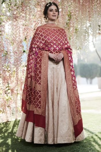 A timeless Benarasi dupatta and off white suit combo for engagement