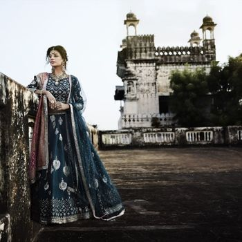 Photo of Blue and silver lehenga with double dupatta, contrasting pink banarasi dupatta.