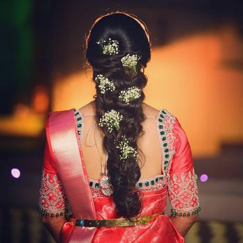 South Indian bridal braid pinned with baby's breaths