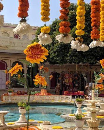 Colourful mehendi decor with marigold flowers