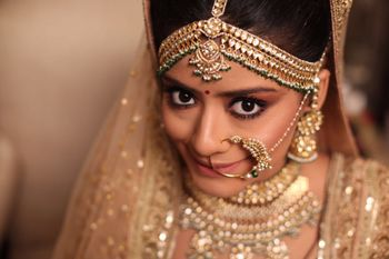 Gold statement mathapatti and vintage bridal nath