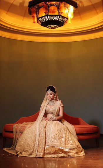 Bridal portrait of bride in gold lehenga