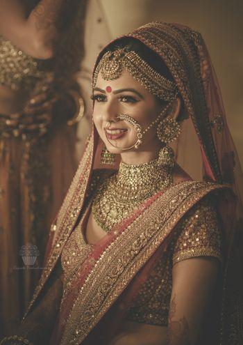 Photo of Bride wearing heavy bridal jewellery