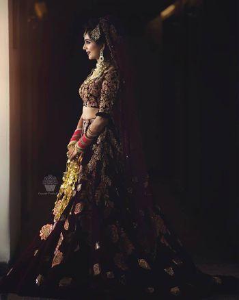 Marsala and gold bridal lehenga