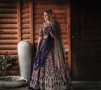 Ink blue and gold embroidered bridal lehenga