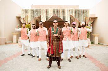 Offbeat groom sherwani with groomsmen