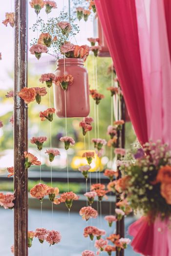 Hanging jars with flowers in decor