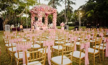 Gorgeous pink decor with a floral mandap