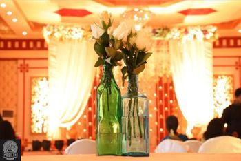 Table setting with glass bottle and flowers