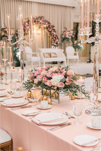 An elegant table setting decor with flowers and candles