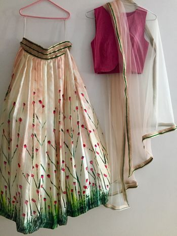 Photo of hand printed cotton georgette lehenga with cherry blossom print and crop top