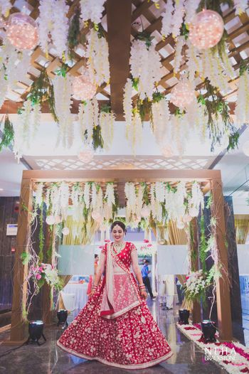 White and pink theme hanging floral strings and fairy lights wedding entrance decor