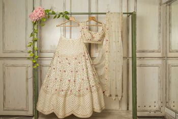 Photo of summery off white lehenga with floral details