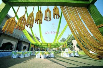 Photo of yellow genda flower curtain in entrance