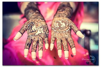 Mehendi with portraits of bride and groom