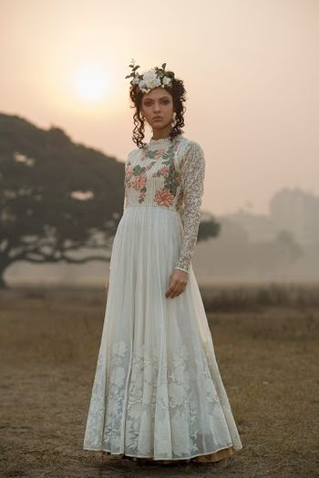 Photo of White floor length anarkali with full sleeves and floral embroidery