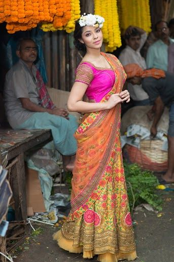 Photo of Olive gold and bright pink lehenga