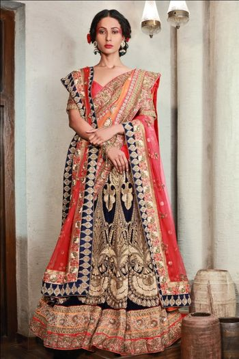 Photo of Red and navy blue bridal velvet lehenga