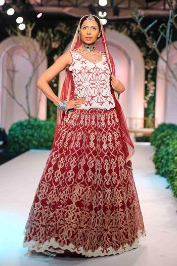 Photo of Red bridal lehenga with white blouse
