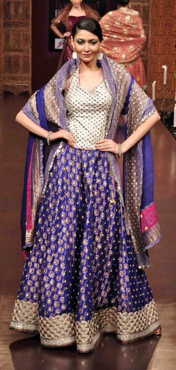 Photo of Navy blue all over embroidered lehenga with sleeveless corset style blouse and blue dupatta