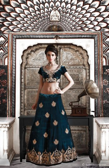 Photo of navy blue bridal lehenga with small motif and short blouse
