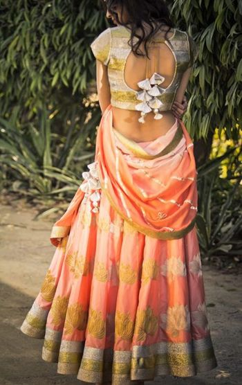 Photo of gold and peach lehenga