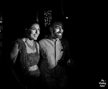 black and white couple reception shot with limelight on them
