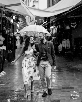 cool black and white couple pre wedding shot in the rain