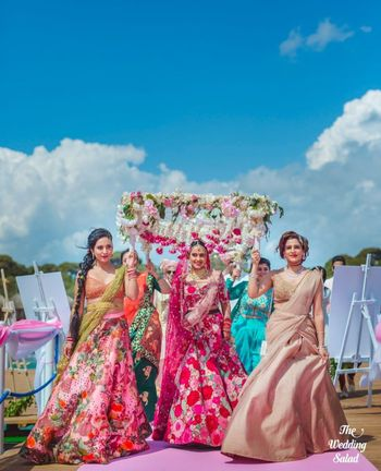 Photo of bridal entry under phoolon ki chadar with her sisters