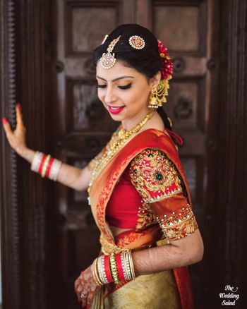 Photo of south indian bridal portrait wearing embroidered blouse in red
