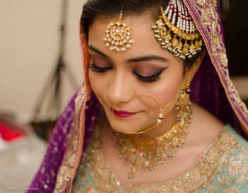 Bride Wearing Gold and Pearl Nath Jhoomer Maangtikka