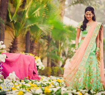 Bride in mint and pink lehenga