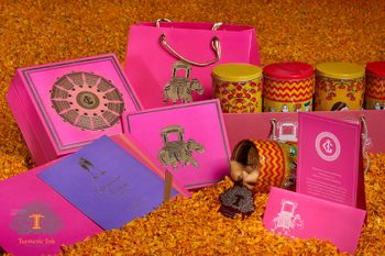 Pink and yellow cards and boxes with elephant motifs