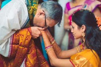 Bride with her father kissing her hands