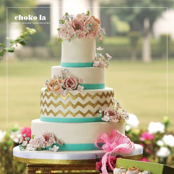 White Wedding Cake with Aqua and Gold Icing