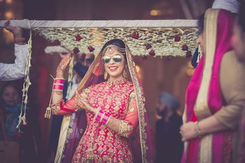 Cool bride dancing and entering wearing sunglasses