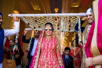 Cool bride under chadar wearing glasses