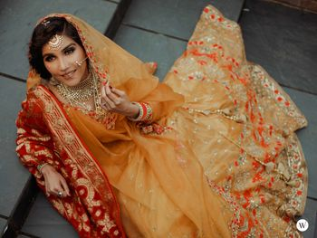 Photo of A bride in a yellow outfit with a contrasting dupatta
