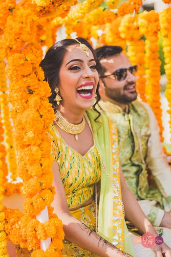 A bride smiling on her Haldi.