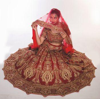 Photo of red velvet bridal lehenga
