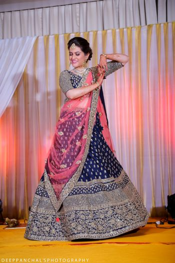 Bride Dancing in Navy Blue Lehenga with Pink Dupatta