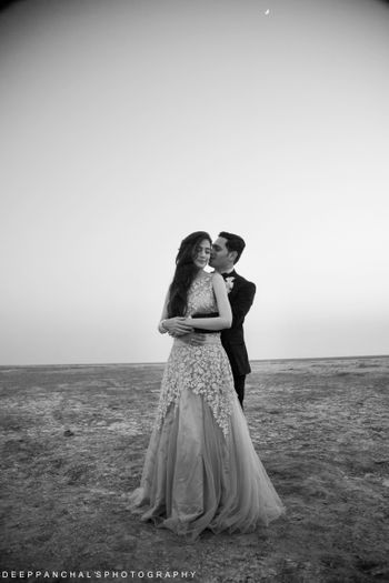 Photo of Romantic black and white pre wedding shoot in gown and tuxedo