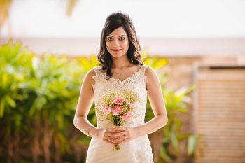 Christian Bride with  Open Hairstyle and Bouquet