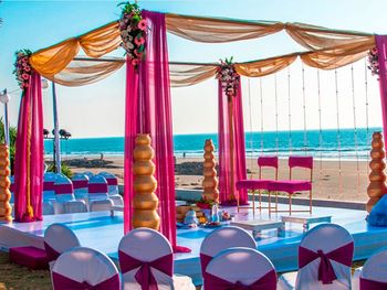 Photo of Minimal beach side floral mandap decor
