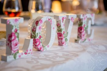 Photo of Love wooden block decor with florals