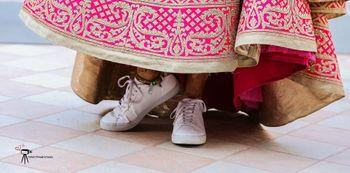 Bride wearing sneakers bridal shoes